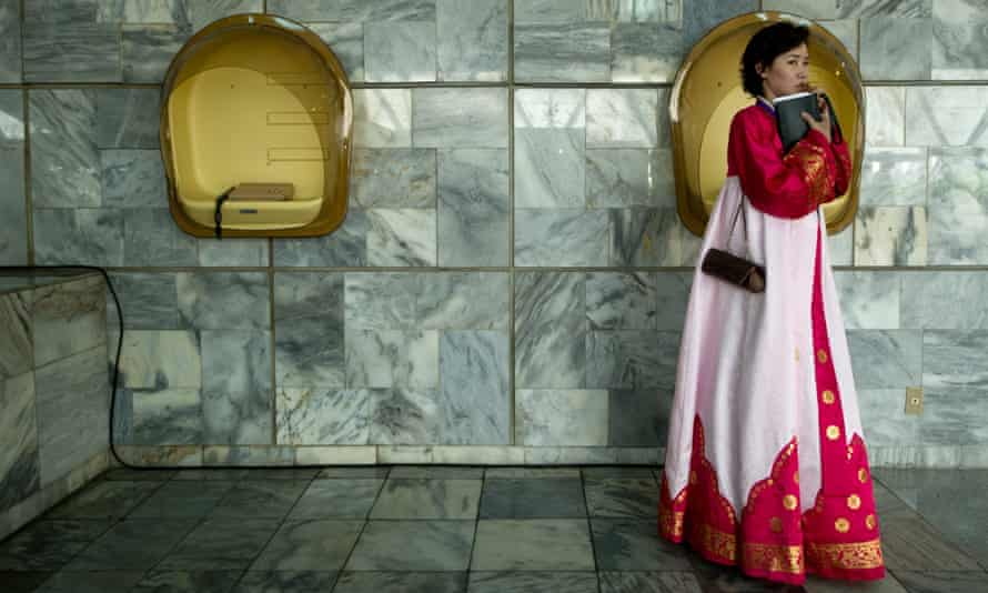 A North Korean woman in traditional dress inside the lobby of the Yanggakdo International Hotel in Pyongyang.