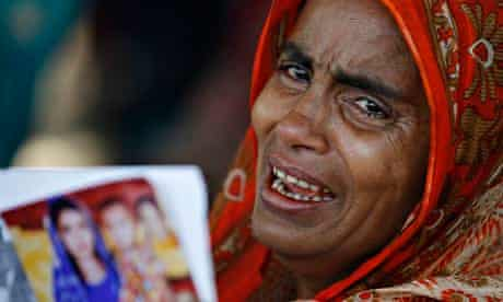 A woman holds a picture of her relative