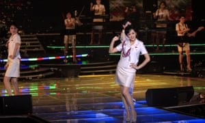 Singers of the Moranbong Band, Jong Su Hyang, foreground, and Pak Mi Kyong, left, perform on stage in Pyongyang, North Korea.