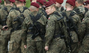 Members of a Polish paratrooper unit assemble before the arrival of soldiers of the US Army 173rd airborne brigade at a Polish air force base  in Swidwin, Poland.
