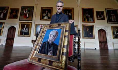 The portrait of the achbishop of Canterbury, Justin Welby, held by its artist Roger Wagner.