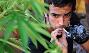 A man smokes cannabis at his home in Montevideo, Uruguay
