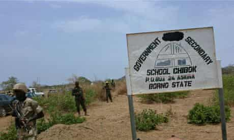 Soldiers guard a government secondary school in Chibok, Nigeria, where gunmen abducted 234 girls