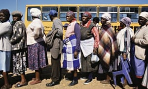 Voters outside a polling station during South Africa's first post-apartheid vote, in 1994