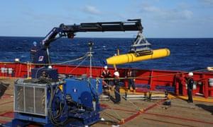 The Bluefin-21 autonomous underwater vehicle is hoisted back on board the Australian vessel Ocean Shield.
