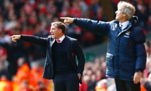 Liverpool manager Brendan Rodgers (L) and Manchester City manager Manuel Pellegrini both aiming for the top of the league, but which does Football Manager think will be successful?