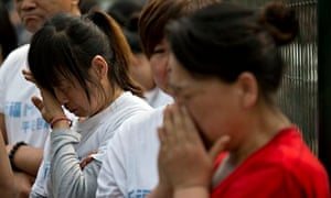 MH370 relatives cry