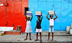 Girls sell eggs in Monrovia, Liberia, West Africa