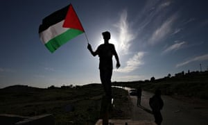 A boy holds a Palestinian flag in the village of Nabi Saleh, west of Ramallah.