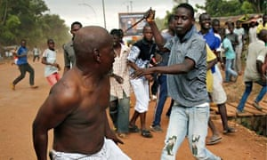 A Christian man chases a suspected Seleka rebel in Bangui, Central African Republic