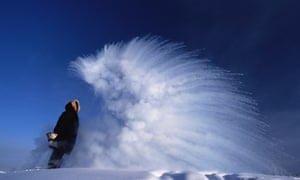 When thrown into cold air at minus 51 degrees Celsius boiling water explodes into vapour & ice. This is because boiling water is close to a gas and breaks into tiny droplets that can freeze at once. Siberia, Russia