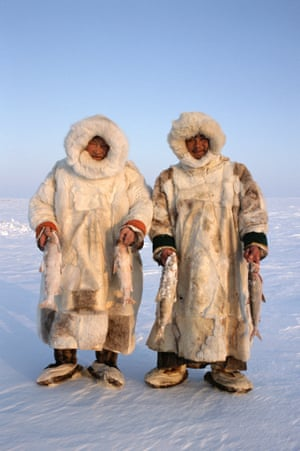 Nenets reindeer herders, Sasha Yeyvi (right) with Sertoharby, his grandfather hold Broad Whitefish they have just caught under the ice. Gydan, W.Siberia, Russia. 2000