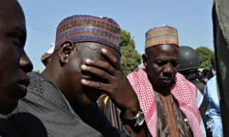 A father weeps as he joins other parents of the kidnapped schoolgirls in Chibok.