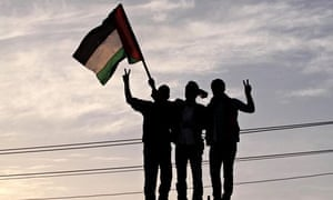 People celebrate in Gaza City after an announcement of a reconciliation between Hamas and Fatah.