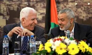 Senior Fatah official Azzam Al-Ahmed (l) with head of Hamas, Ismail Haniyeh