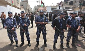 Palestinian security forces stand guard in Gaza City