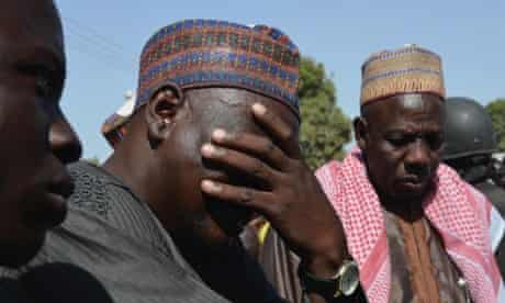 A man weeps as he joins parents of kidnapped school girls during a meeting with the Borno State governor in Chibok, Maiduguri, Borno State.