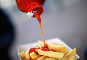 A supporter pours ketchup on his chips ahead of  the Premier League match between Southampton and Everton at St Mary's Stadium.