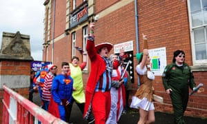 Scunthorpe United fans arrive in fancy dress ahead of the League Two match against Exeter City.