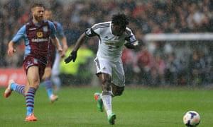 Swansea City's Wilfried Bony scores.