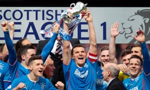 Rangers' Lee McCulloch celebrates with the trophy and team mates after his team won Scottish League One.