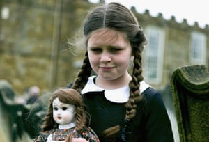 Colette Rimmer, 10, from Wigan poses with a spooky doll.