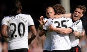 Fulham's Fernando Amorebieta is mobbed.