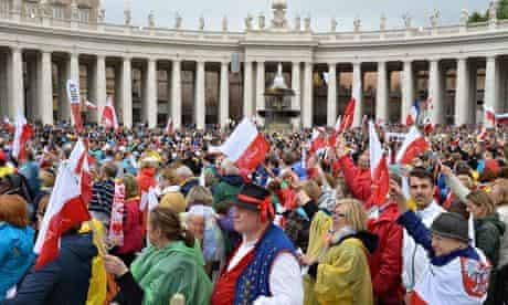 Pilgirms attend the canonisation mass of Popes John XXIII and John Paul II