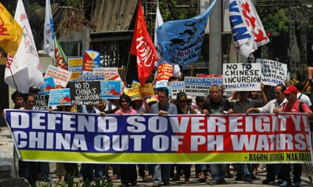 Protesters display a banner and placards while marching towards the Chinese consulate in Manila. philippines