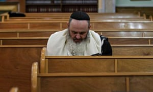 A Jewish man attends the morning prayer at a synagogue in Donetsk, Ukraine.