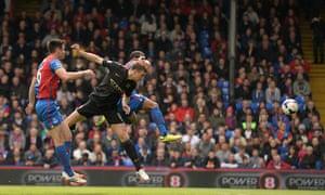 Edin Dzeko rises to put Manchester City ahead.