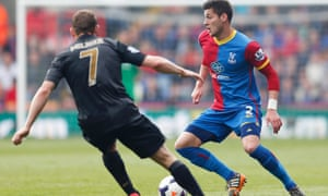 Manchester City's James Milner and Crystal Palace's Joel Ward in action.
