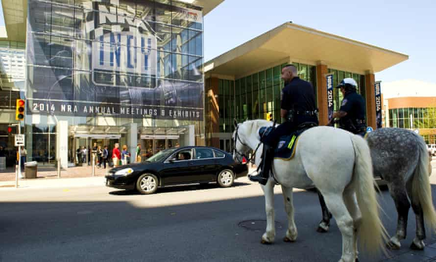 Mounted police officers watch one of the entrances at the 143rd NRA Annual Meetings and Exhibits at the Indiana Convention Center in Indianapolis, Indiana