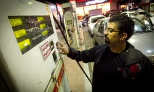 A man refuels his car at a gas station in Tehran. Iranian officials announced fuel price hikes, prompting a rush to the pumps before President Rouhani's new subsidy plan was to take effect.