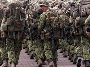An Australian soldier looks back as troops return to their barracks in Darwin, northern Australia.