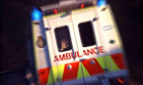 Rear view of an ambulance, blue lights flashing and hand pressed against window as it speeds off