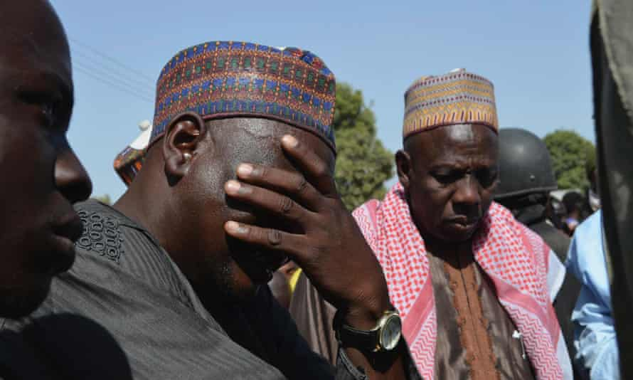 A man weeps as he joins parents of kidnapped school girls during a meeting with the Borno State governor in Chibok on 22 April 2014.