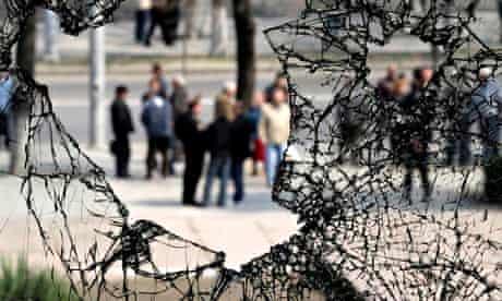 Broken windows of the ransacked parliament building in Moldova