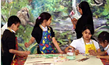 children paint a mural