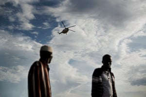 A helicopter bringing emergency aid approaches the town of Ganyiel