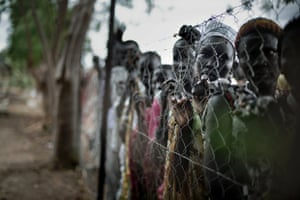 Ganyiel, Unity State, South Sudan, 17 April 2014: Women waiting in line for a chance to get one of the tarpaulins handed out by an aid organisation.