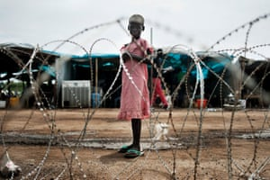 A girl stands inside the UN mission in South Sudan's military base in Tomping