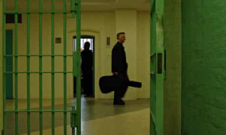 Billy Bragg delivers guitars to Wormwood Scubs prison.