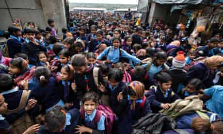 Girls leave school in New Delhi