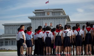 North Korean school children stand before the portraits of late North Korean leaders Kim Il-sung (L) and Kim Jong-il (R) at the Kumsusan Palace of the Sun mausoleum in Pyongyang.