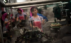 North Korean employees work in a textile factory in Pyongyang in April, 2012.