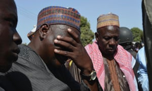 A man weeps as he joins parents of kidnapped school girls during a meeting with the Borno State governor in Chibok, Maiduguri on 22 April, 2014.