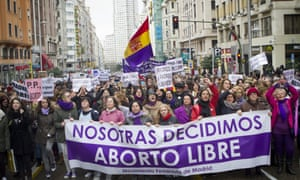 Women protest in Madrid against a draft bill on abortion that would restrict their reproductive rights.
