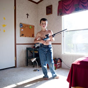 Benjamin, aged 7, from Louisiana, with his rifle, photo by An-Sofie Kesteleyn