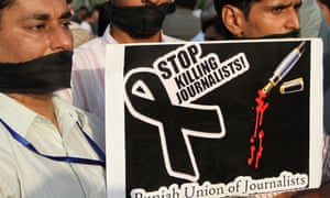 Pakistani journalists hold a placard during a protest against the killing of journalist Syed Saleem Shahzad, in Lahore, in 2011.